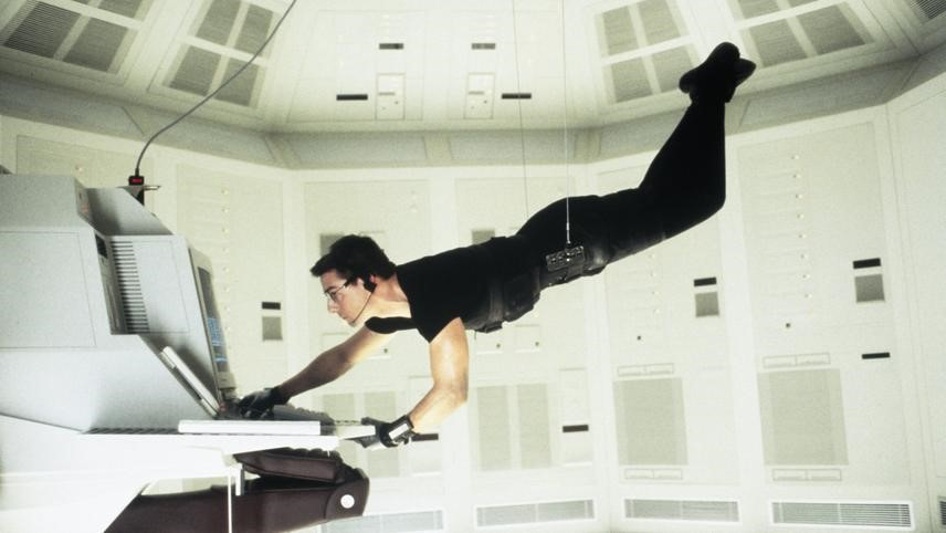 Tom Cruise barging into server room from film Mission Impossible