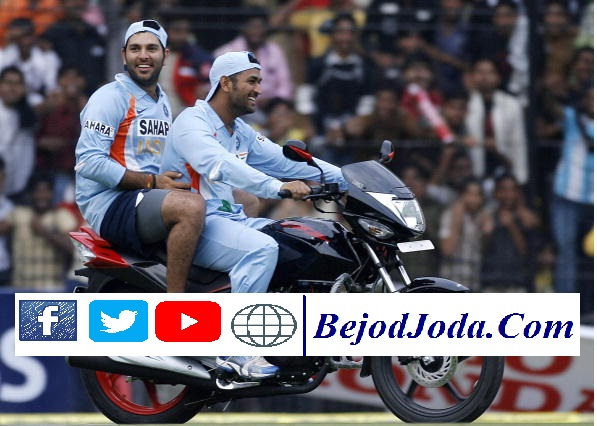 Indian cricketer Mahindra Singh Dhoni (R) rides the motorcycle awarded as a prize to teammate and man of the match Yuvraj Singh (L) who rides pillion during the second One Day international (ODI) match between England and India in Indore on November 17, 2008. Hosts India defeated England by 54 runs to take a 2-0 lead in the seven-match one-day series. AFP PHOTO/RAVEENDRAN (Photo credit should read RAVEENDRAN/AFP/Getty Images)